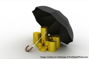 freedigitalphotos_umbrella gold coins